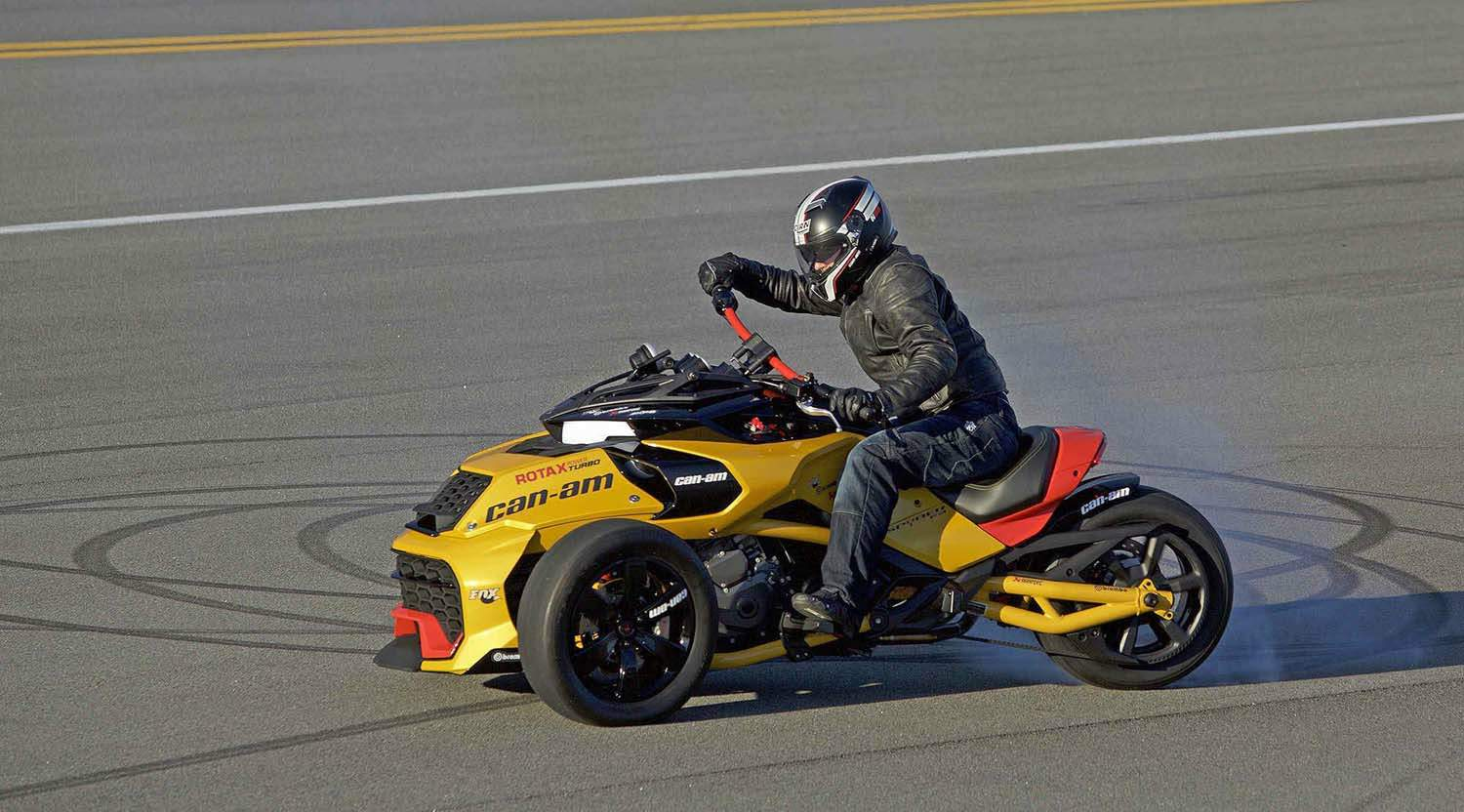 Nascar sprint cup series driver jeffrey earnhardt sits on the recently unveiled can am spyder f3 turbo concept vehicle